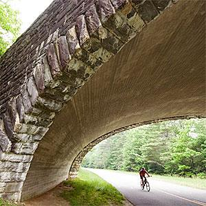 Bicyclist under bridge